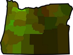 outline of state of oregon with counties shown in shades of green