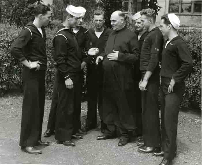 V-12 Members with Br. Peter Buskens, S.J., 1945