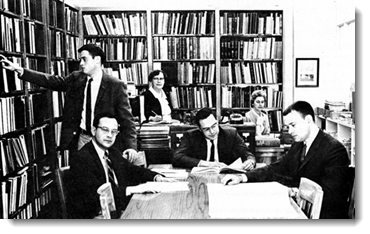 Black and white image of researchers in suits at the library in Thornton Hall, 1967.