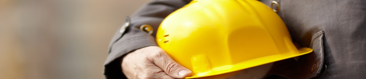 holding a hardhat
