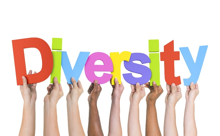 "Hands holding up the word ""diversity"""