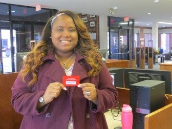picture of student holding library card