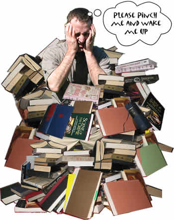 "image of a frustrated man standing in a pile of books thinking ""please pinch me and wake me up"""