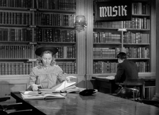 Still from 1948 film Letter from an Unknown Woman. A woman sits in a Vienna library trying to research her lost love.
