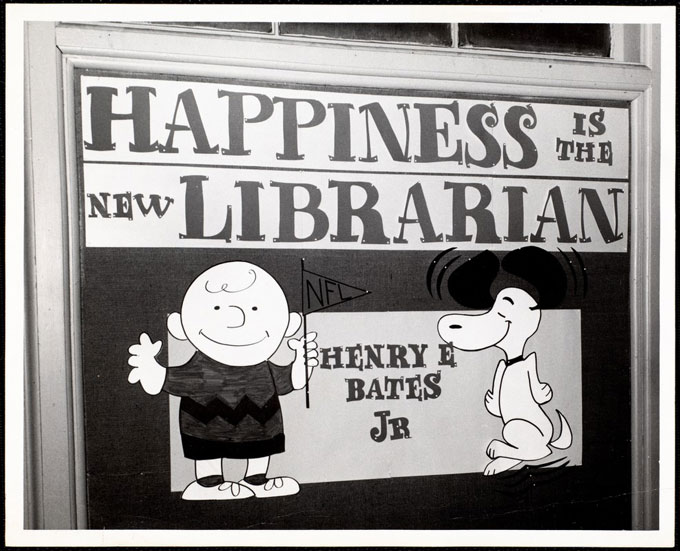 """Newton Free Library, Newton, MA. Staff & trustees. Sign ""Happiness is the new librarian, Henry Bates""."