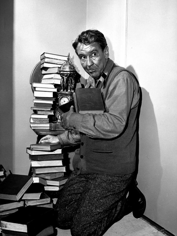 Screenshot from The Obsolete Man, Twilight Zone episode. A desperate librarian in a totalitarian society tries to safeguard his illegal books.