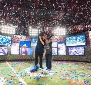 two young boys in the super bowl celebration room at the nfl experience in Times Square