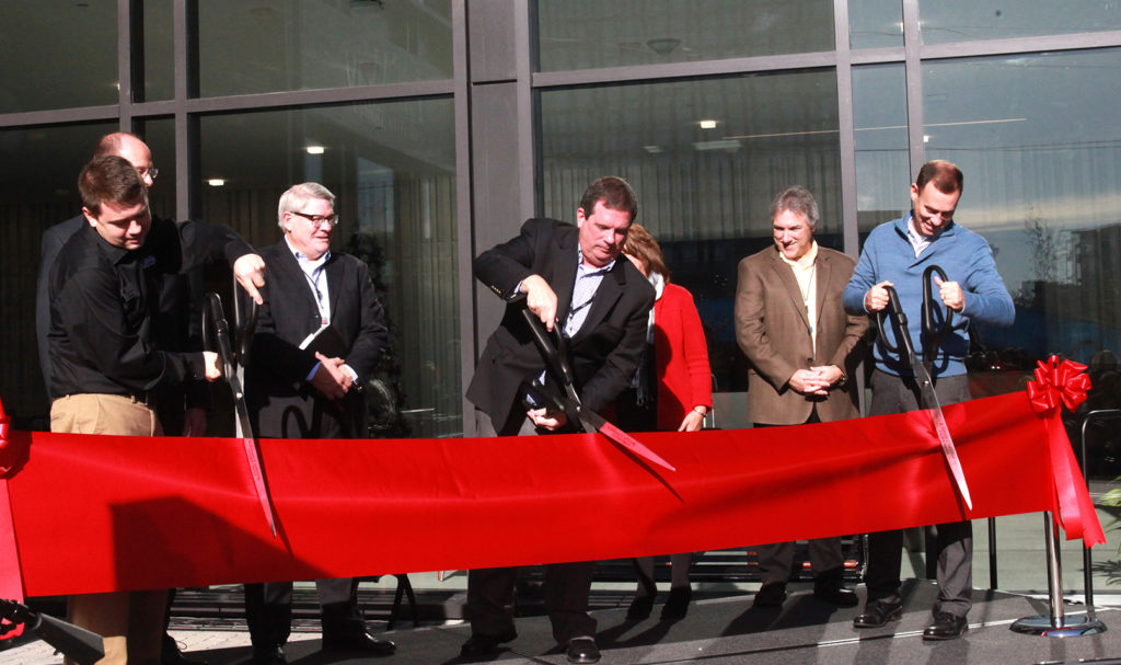 LifeWay President and CEO Thom S. Rainer (center) is joined by Carlton Capps, manager of the Nashville LifeWay Store (left), Eric Geiger, LifeWay's senior vice president and CBO (right), and members of the executive leadership team in cutting the ribbon to celebrate the grand opening of LifeWay's new corporate headquarters and LifeWay Store. Photo by Katie Shull