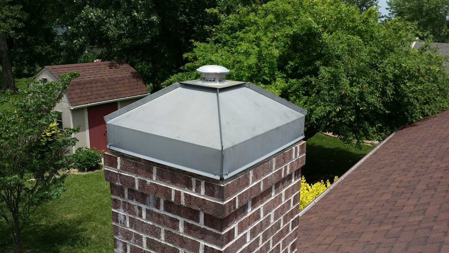 Custom chimney cap experts in Columbia, Mo! Call Accurate Heating & Cooling today!