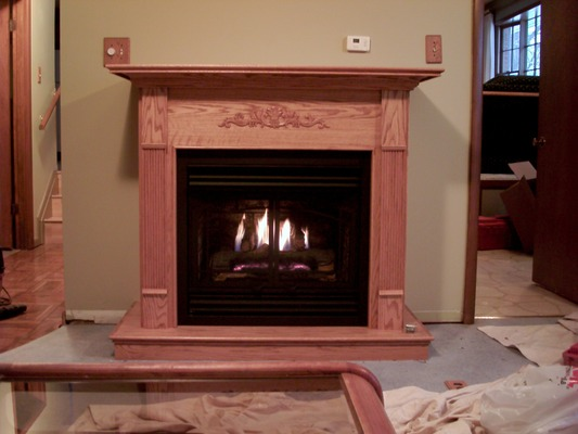 A fireplace with a wooden exterior