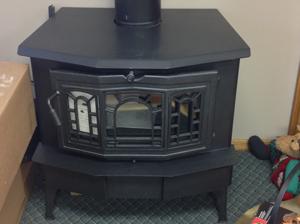 A black gas burning fireplace inside