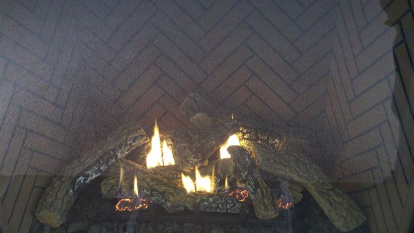 A fire over wooden logs