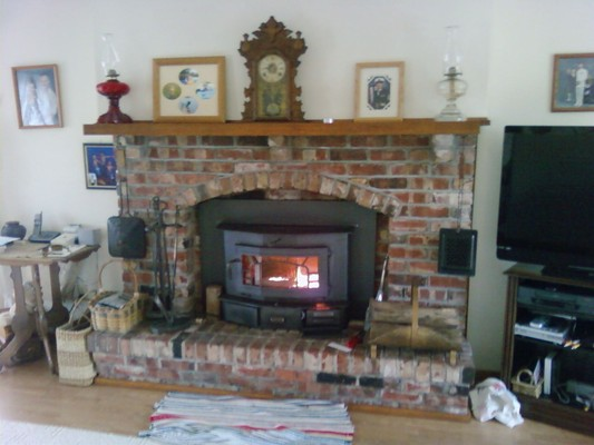 A warm fireplace inside someone's house