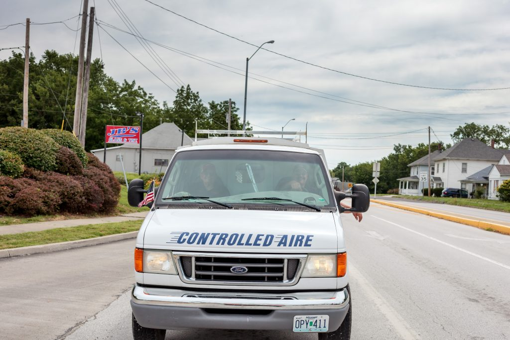 Two Controlled Aire employees driving to a heating and air conditioning project