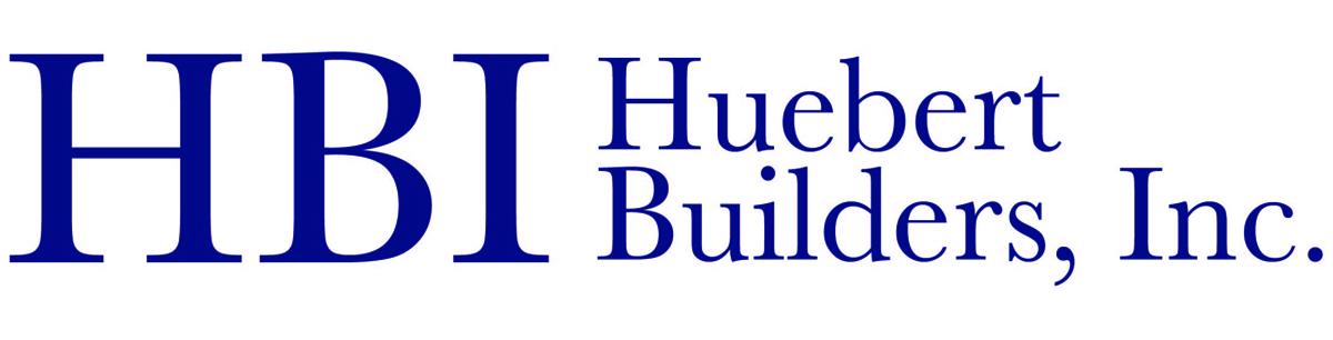 Navy logo for Huebert Builders, Inc.