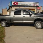 Side view of gray Ram 3500 pickup truck at KB Tire & Auto