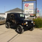 Front view of black Jeep Cherokee at KB Tire & Auto