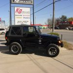 Side view of black Jeep Cherokee at KB Tire & Auto
