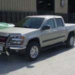 Front view of tan GMC pickup truck at KB Tires & Auto