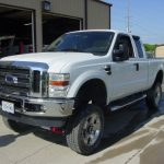 Front view of white Ford pickup truck at KB Tires & Auto