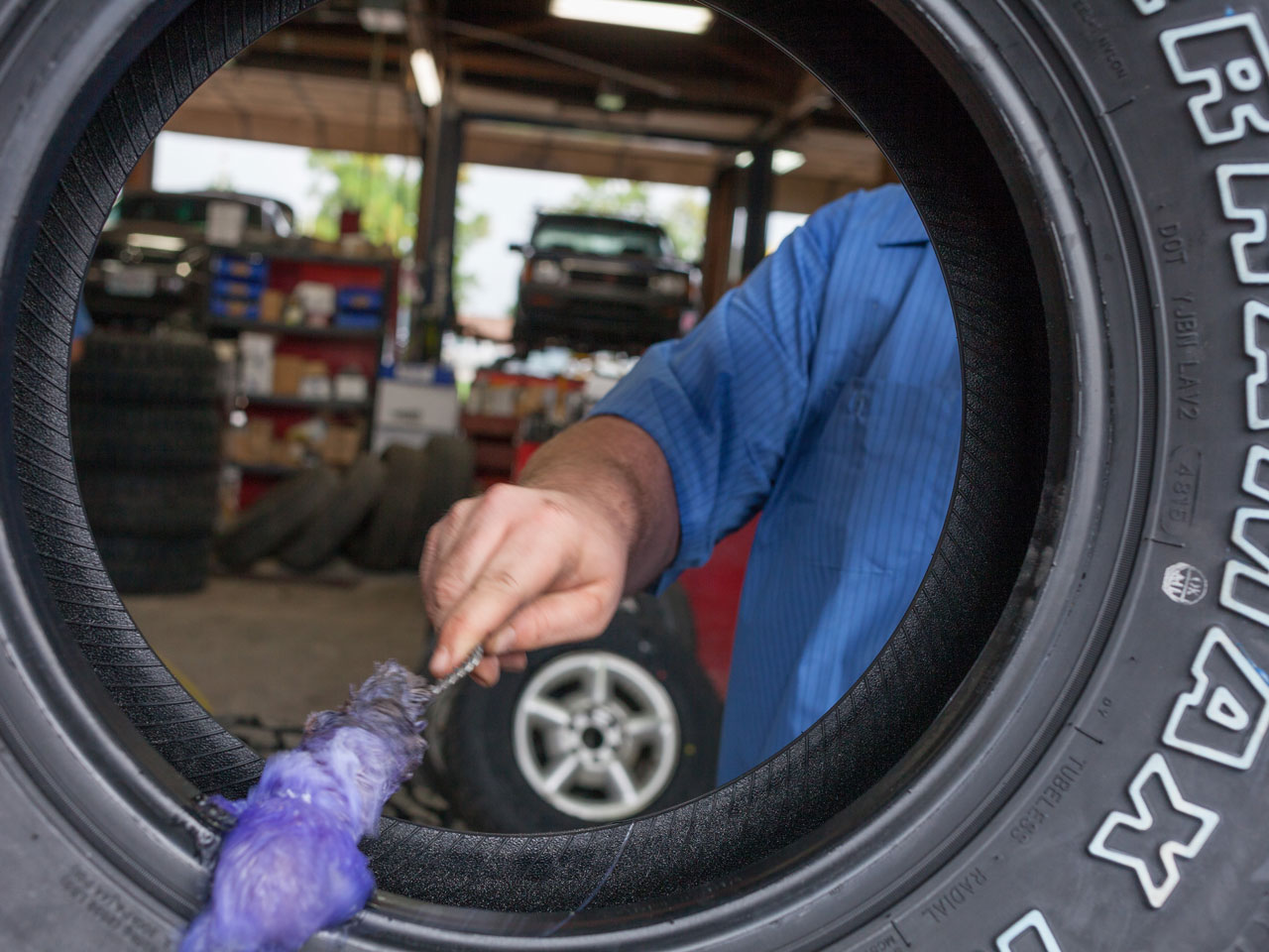 Technician cleaning a car tire