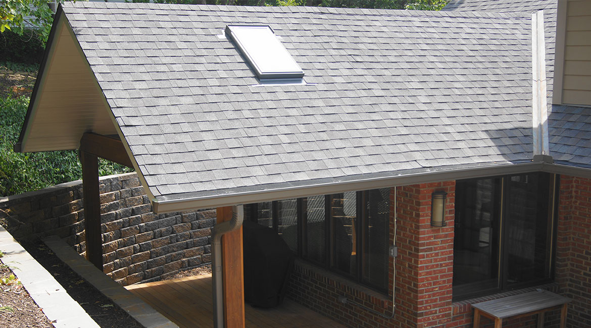 Covered patio with solar panel by TrueSon Exteriors