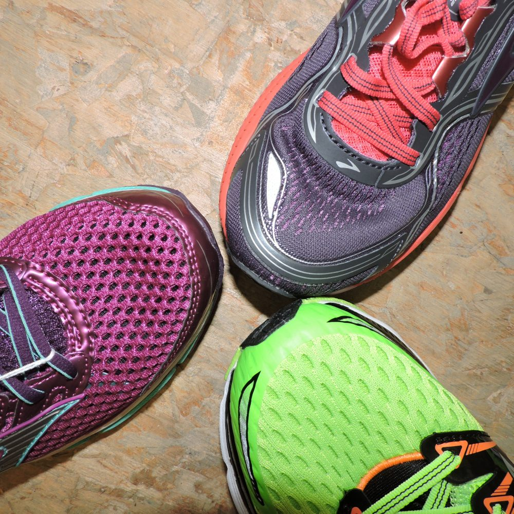 arial view of three single shoes in a triangle formation
