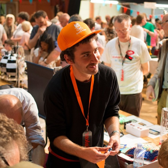 A maker presents laser cutting to visitors at Brighton Mini Maker Faire. Photo courtesy of Justin Pickard.