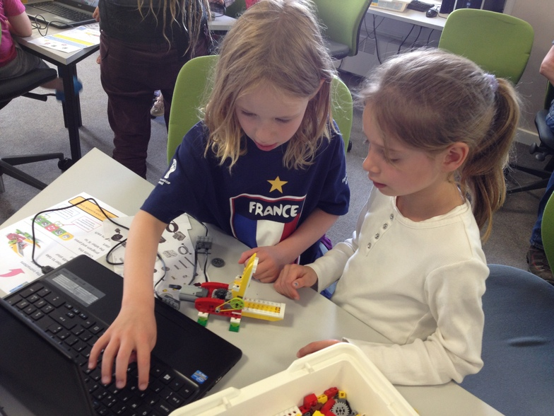 Participants get to grips with robotics at a previous workshop.