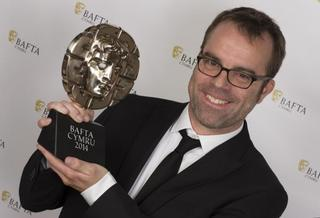 Chris Forster collecting his BAFTA CYMRU award for The Portrait