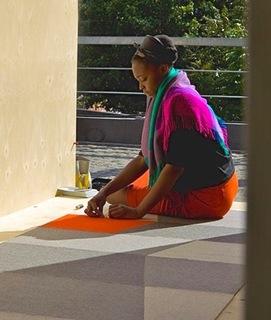 Yemi Awosile creating a textile