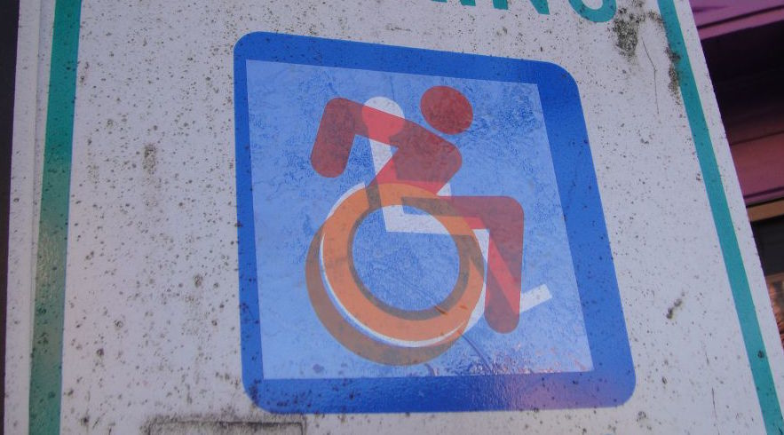 Graphic street intervention from The Accessible Icon Project. http://accessibleicon.org. Photo by Brian Funck
