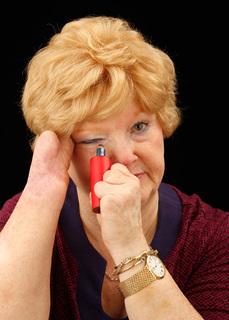 Cindy applying make-up using an adapted soft-grip tube. Photo: Michael J. Maloney
