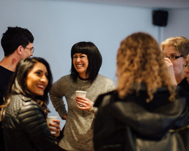 Speakers and attendees talking and sharing ideas in the break during the Reframed Talks. Photo: Zoe Manders.