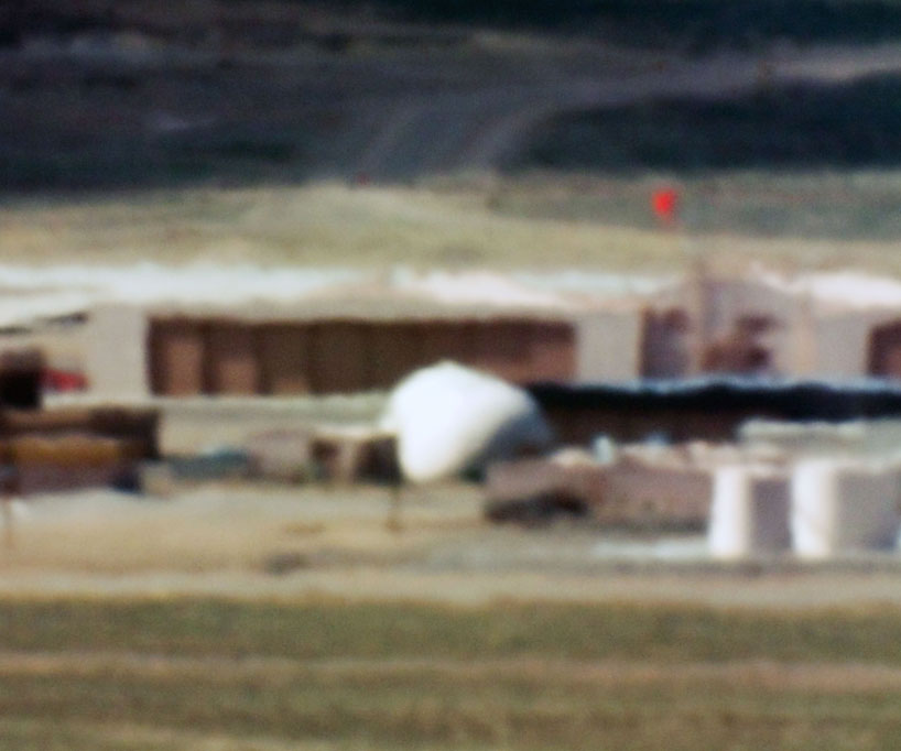 Large Hangars and Fuel Storage, Tonopah Test Range, NV, Distance ~ 18 miles, 10:44 a.m. (2005) © Trevor Paglen. Courtesy of Galerie Thomas Zander, Cologne and Altman Siegel Gallery, San Francisco.
