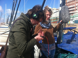 MA students recording sounds on Brighton seafront for artist group Invisible Flock's interactive piece 'Sea of Voices'