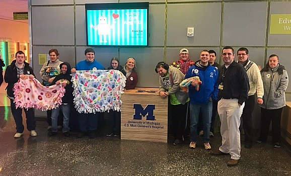 LISD TECH Center Adult Transition Student Services (ATSS) students visited Mott's Children Hospital today (President's Day) to donate 5 blankets they made.