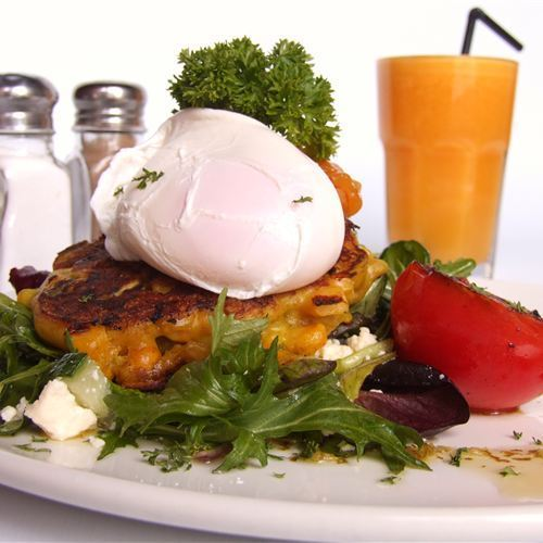 Corn Fritter with poached egg & orange juice