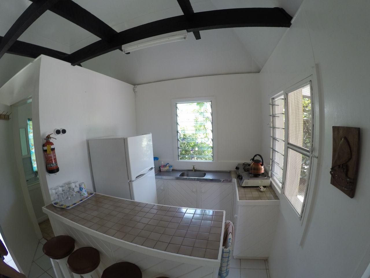 Kitchen in Standard Cottage Bure at Macdonalds Cottages Fiji
