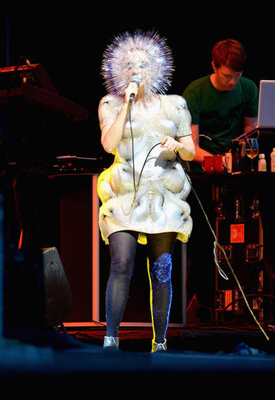 Bjork, sporting an outfit that both entices and scares the bejesus out of rolling concert-goers.