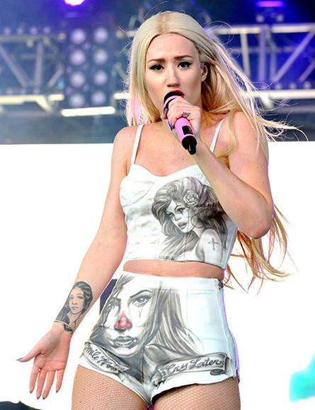 Iggy Azalea is watching you... and so is her shirt, and her pants, and her forearm...