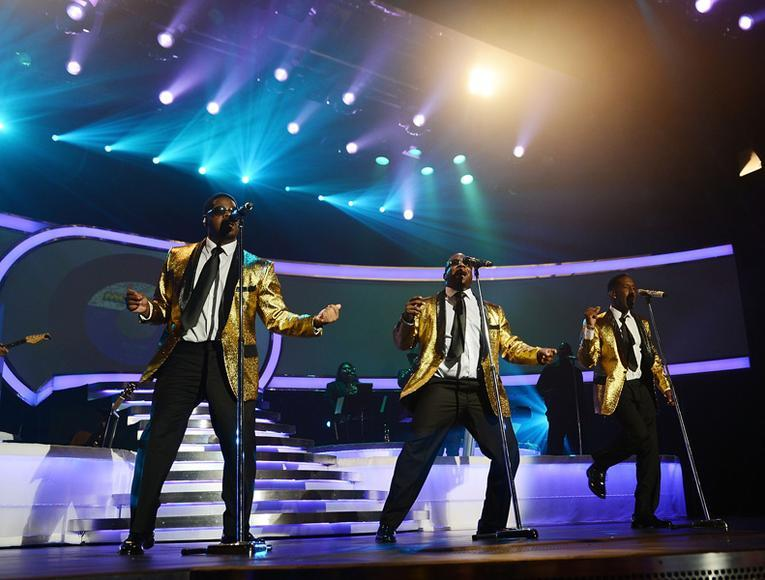 "Boyz II Men (ON TOUR) - Would you say it's ironic that their first #1 single was ""End of the Road"" in '92, when it was actually the BEGINNING of the road for them? We know, bad joke. Whatever."