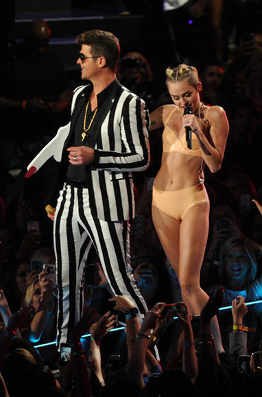 In case anyone was having trouble picturing Miley Cyrus disrobed...