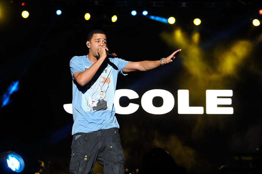 """J. Cole: Forbes calls him a music mogul in the making, but more importantly his """"Crooked Smile"""" is oh so charming."""