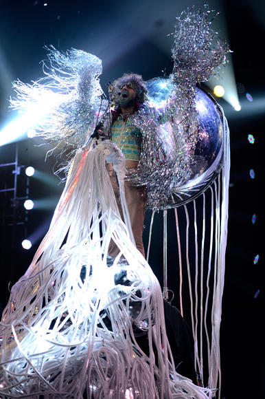 The Flaming Lips: The Flaming Lips are sort of infamous for their ridiculous staging at live shows.  Lead singer Wayne Coyne has a giant plastic bubble he crowdsurfs in. That's it.  That's all you need to know.
