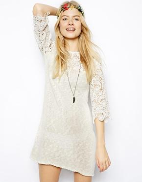 Crochet Dress: Perfect for Woodstock or Coachella, a crochet dress will summon your inner flower child.