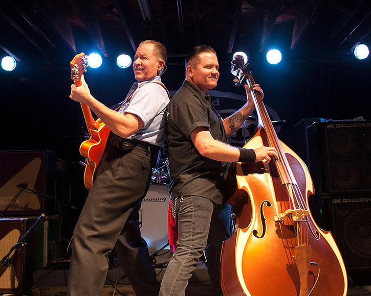 Reverend Horton Heat: If you think you see an upright bass on stage during this set, I promise that you are not hallucinating.  This punkabilly trio, who sometimes dip into rockabilly and psychobilly, mix genres like a good bartender mixes drinks.  Don't know what any of those words mean?  Let the good Reverend share the gospel with you.