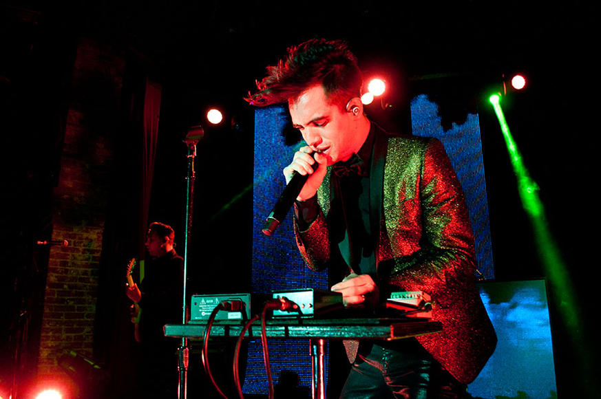 "Panic! at the Disco: If the exclamation point in the band's name doesn't excite you, then we can assure you their eclectic rock sounds will. From heavy synth lines to cues taken from vaudeville hits, there is a reason these Las Vegas boys declared themselves ""Too Weird To Live, Too Rare to Die."""