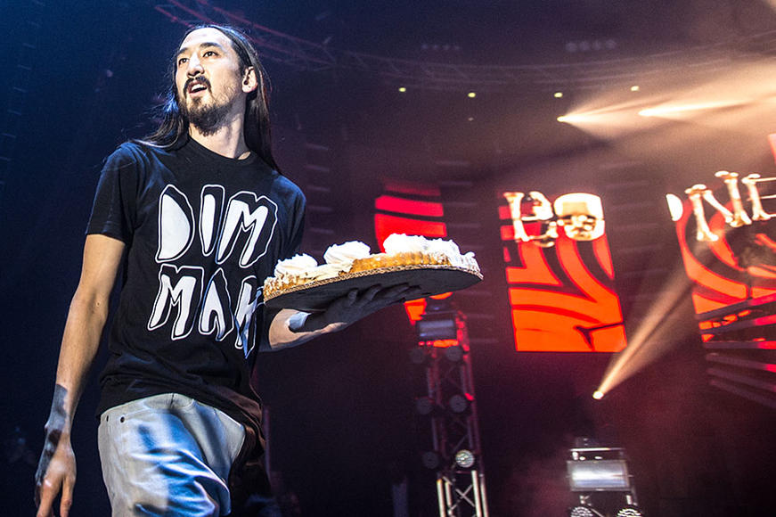 Steve Aoki: We're used to his shows involving crowd surfing (yay!) and cake throwing (aw, cake, no), but this electro-house DJ may pull off his best stunt ever. You see, he's booked for MIA fest in BOTH Philly and LA.  A coast to coast race to rock your world?  We'll be watching.