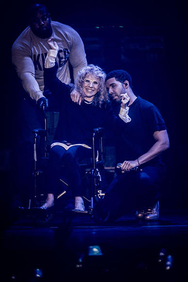 Drake brings his mom, Sandi Graham, on stage during the festival.